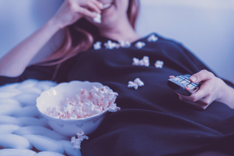 eating popcorn watching tv
