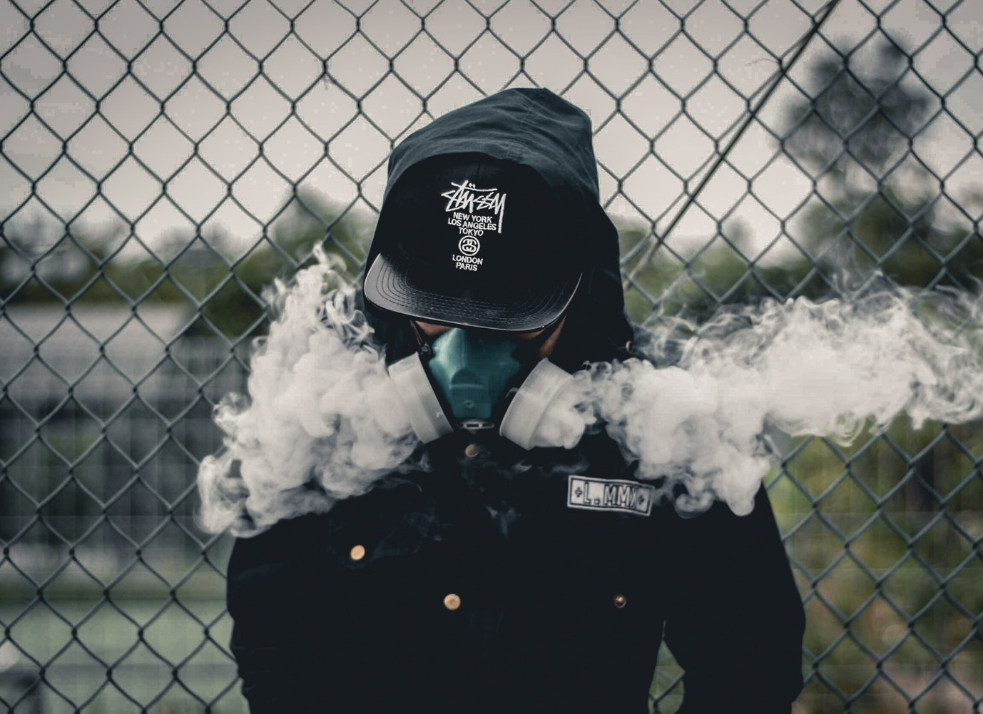 man in gas mask with smoke